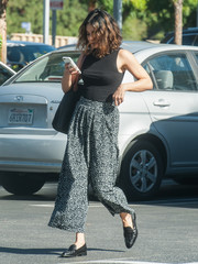 Vanessa Hudgens capped off her look with a pair of black crocodile loafers by Everlane.