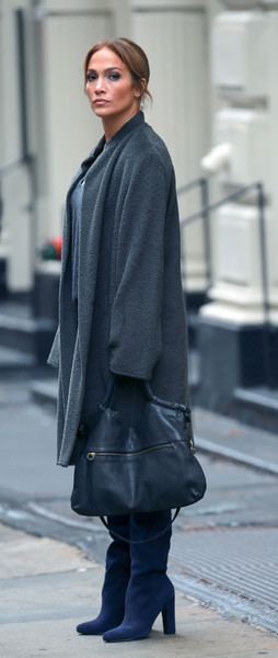 Jennifer Lopez was seen on the set of 'Second Act' sporting a leather tote, coat, and boots combo.