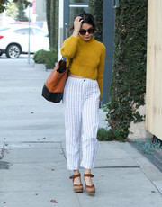 Vanessa Hudgens chose a pair of striped pants to team with her sweater.