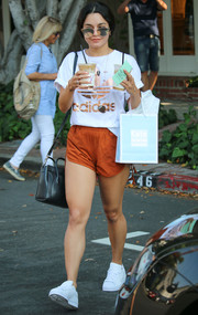 Vanessa Hudgens went for comfy dressing in a white and rose-gold Adidas logo tee for a lunch out.