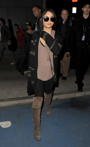 Vanessa Hudgens wore black leggings under her over-the-knee suede boots.