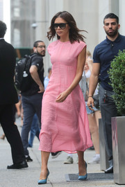 Victoria Beckham was equal parts sweet and sexy in a semi-sheer pink midi dress from her label while out and about in New York City.