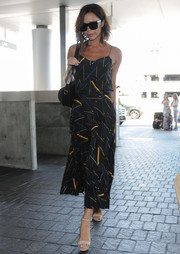 Victoria Beckham went for a summer-chic airport look with this printed cami from her own line.