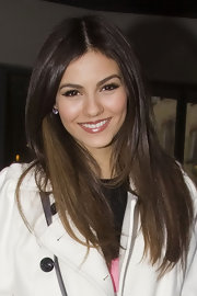 Victoria Justice was out in London wearing her long hair smooth and straight.