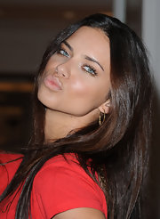 Adriana Lima showed off a glossy pout at the Victoria's Secret soiree in Miami Beach, Florida.