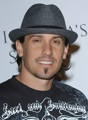 Carey Hart attended the Victoria's Secret party wearing a gray herringbone fedora with his edgy tee.