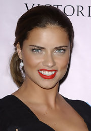 Adriana added a touch of glamor with shimmering silver eyeshadow.