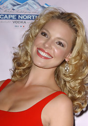 Katherine Heigl was all smiles at the Victoria's Secret Super Bowl party with her hair styled in bouncy curls.