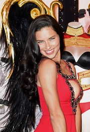 Adriana Lima looked ultra girly with her sculpted curls during the Victoria's Secret photocall.