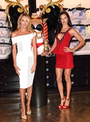 Candice Swanepoel showed off her super-slim figure in a white Roland Mouret off-the-shoulder dress during the Victoria's Secret Angels photocall in London.