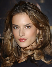 Alessandra Ambrosio puckered up in shiny pink lipstick.