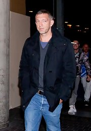 Vincent Cassel chose a basic pea coat for his travel look while leaving LA.