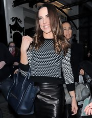 Mel C accessorized with a simple yet chic Prussian blue leather tote at the Viva Forever! cocktail launch.