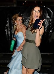 Mel C complemented her dress with a navy hard-case clutch at the Viva Forever! press night.