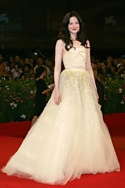 Andrea shined in a pale yellow couture gown, complete with a draped bodice and rhinestone-encrusted tulle skirt.