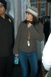 Courteney Cox kept warm in a striped gray brown and white crocheted beanie.
