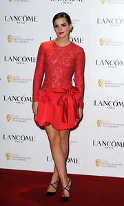 Emma accessorized her red lace frock with black patent leather pumps complete with criss-cross straps.