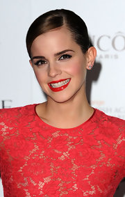 Emma Watson finished off her look with a sleek side-parted French twist.