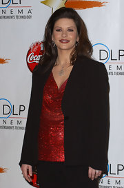 Catherine Zeta Jones donned a classic black blazer over her sparkly red top.