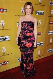 Sasha Alexander looked radiant in a black satin ruched gown with a fuchsia and orange floral print.