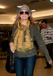 Raquel Welch bundled up in a paisley scarf for her arrival at LAX.