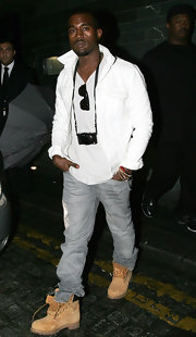 Kanye loves his Timberland boots. He incorporates them with most of his looks.