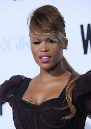 Eve wore a bold teased ponytail with eye-skimming bangs when she attended the 'Whip It' premiere.