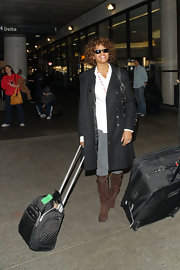 Whitney Houston pulled her quilted rollerboard as she and her hubby Bobbi Brown arrived at LAX.