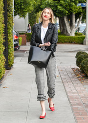 A black leather tote with metal ring handles completed Whitney Port's ensemble.