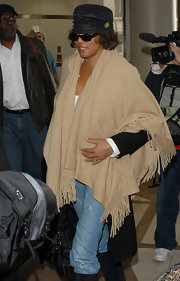 Whitney Houston departed LAX wearing a stylish ensemble including a tan poncho.
