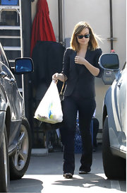 Olivia Wilde added polish to her flares with a classic black blazer.