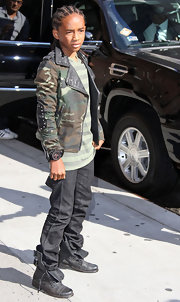 Jaden goes military chic in a leather embellished camo jacket.