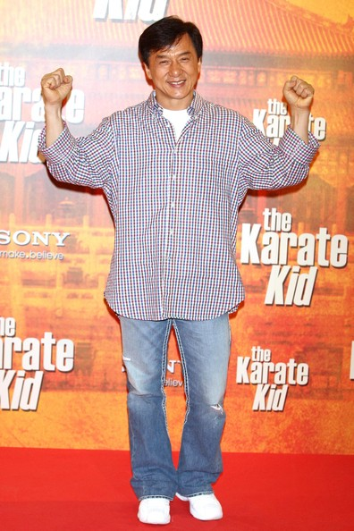 Jackie wears a casual plaid button-up with jeans for 'The Karate Kid' photo call.