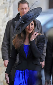 Kate donned a decorative wide brimmed hat. The black hat is embellished with long feathers.