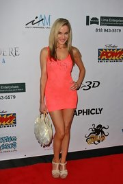 Paula Labaredas looked extremely flirtatious in this little coral number.