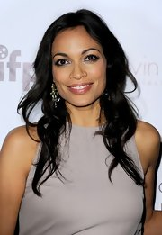 Rosario Dawson styled her hair in loose curls while attending the Woman of Cannes event.