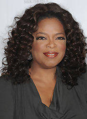 Oprah Winfrey sported a lovely high-volume curly 'do at the Women in Entertainment Breakfast.