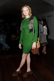 Lily Cole sported a simple yet stylish green sweater dress at the World Chess Grand Prix.