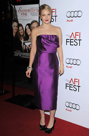 "Drew looked radiant in a rich purple ""Giral Strapless Shot Silk Dress""."