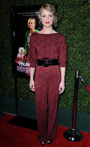 Collette was playful with her red carpet ensemble at the 'Young Adult' premiere, choosing to wear a red print jumpsuit with a black belt.