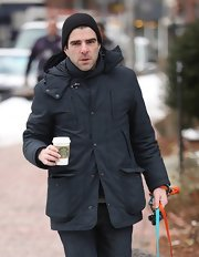 Zachary Quinto warmed up with a charcoal down jacket while out walking his dog in Massachusetts.