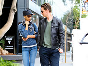 Zoe Saldana tossed on a short-billed hat and scarf for her winter ensemble.