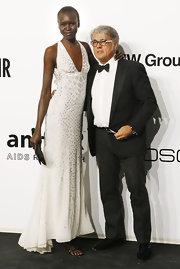 Supermodel Alek Wek kept her white dress from feeling prim with a gorgeous black strappy sandal.