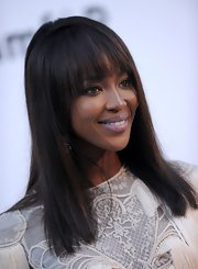 Naomi Campbell styled her hair in a sleek straight cut with blunt cut bangs that framed her gorgeous face.