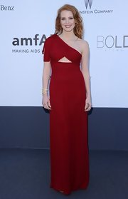 Jessica Chastain put to rest the myth that redheads can't wear red when she dazzled in this one-shoulder gown that featured a delicate triangular cutout under the bust.