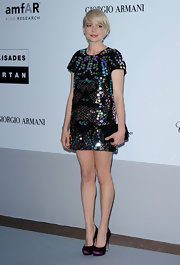 Michelle opted for a sparkling cocktail dress and a quilted clutch while attending the amfAR party.