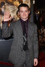 Elijah Wood arrived at the 'Lord of the Rings' premiere with a striped suit on.