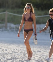 Jessica Hart showed off her slim physique in a mixed-print halter bikini while spending a day at the beach.