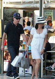 Patty Smyth looked all set for summer in a white baby doll dress.