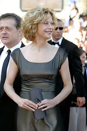 Meg walked the carpet at the Cannes Film Festival carrying a silver box clutch in hand.
